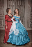 Two beautiful women in medieval dresses Stock Photos