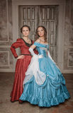 Two beautiful women medieval dresses Royalty Free Stock Photos
