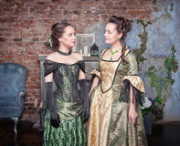 Two beautiful women in medieval dresses Stock Image