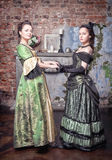 Two beautiful women in medieval dresses Royalty Free Stock Images