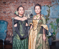 Two beautiful women in medieval dresses Royalty Free Stock Photography