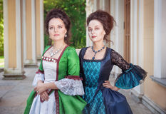 Two beautiful women in medieval dresses Royalty Free Stock Image
