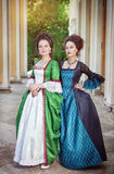Two beautiful women in medieval dresses royalty free stock photos