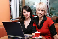 Two beautiful women meeting over coffee Royalty Free Stock Image