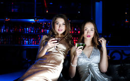 Two beautiful women in night club Royalty Free Stock Photography