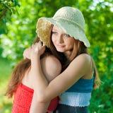 Two Beautiful women outdoors embracing Stock Image
