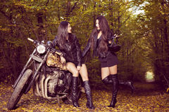 Two beautiful women passionate about motorcycles Stock Photo