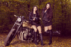 Two beautiful women passionate about motorcycles Royalty Free Stock Image