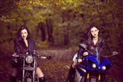 Two beautiful women passionate about motorcycles Royalty Free Stock Photography