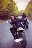 Two beautiful women passionate about motorcycles Royalty Free Stock Photo