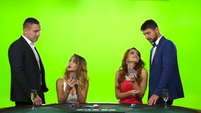 Two beautiful women playing at the poker table. Slow motion stock video