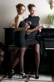 Two beautiful women with red wine Royalty Free Stock Photography