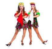 Two beautiful women russian traditional folk dance. Two beautiful women striptease dancers performing russian traditional folk dance, isolated against white stock photos