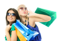 Two beautiful women with shopping bags Stock Image