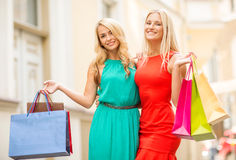 Two beautiful women with shopping bags in the ctiy Stock Images