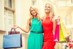 Two beautiful women with shopping bags in the ctiy Stock Photography