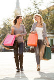 Two beautiful women in shopping Royalty Free Stock Images