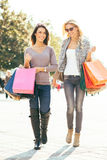 Two beautiful women in shopping Royalty Free Stock Photo