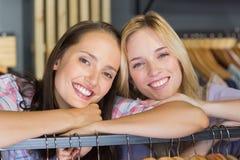 Two beautiful women smiling at camera Stock Photos