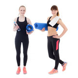Two beautiful women in sportswear with yoga mats isolated on whi Royalty Free Stock Images