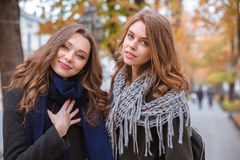 Two beautiful women standing outdoors Stock Photography