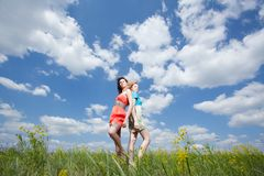 Two beautiful women standing  on summer field Stock Images