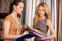 Two beautiful women talking in store. Stock Photography