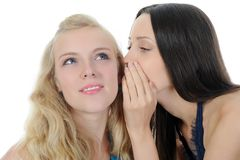 Two beautiful women telling secret Royalty Free Stock Photos