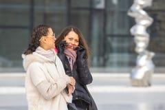 Two Beautiful Women On urban background Stock Image