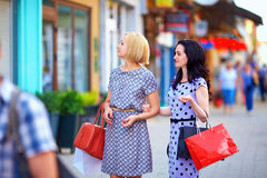 Two beautiful women walking the city street Royalty Free Stock Photography