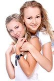 Two beautiful women in a white T-shirts Royalty Free Stock Photo