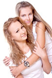 Two beautiful women in a white T-shirts Royalty Free Stock Image