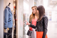 Two beautiful women window shopping Royalty Free Stock Photos