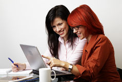 Two beautiful women are working Stock Photography