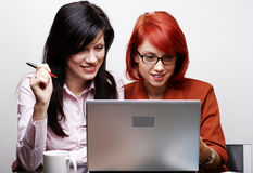 Two beautiful women are working royalty free stock photos
