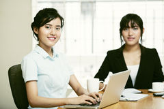 Two beautiful women working together Royalty Free Stock Image