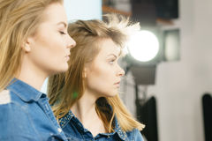 Two beautiful young blonde serious women Stock Images
