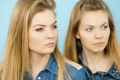 Two beautiful young blonde serious women Royalty Free Stock Photos