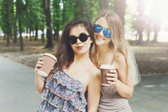 Two beautiful young boho chic stylish girls walking in park. Royalty Free Stock Photos