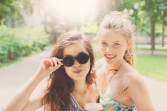 Two beautiful young boho chic stylish girls walking in park. Stock Images
