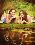 Two beautiful young brunet woman outdoors Stock Photos