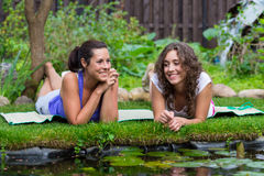 Two beautiful young brunet woman outdoors Royalty Free Stock Image
