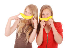Two beautiful young caucasian girl with banana smile Royalty Free Stock Images