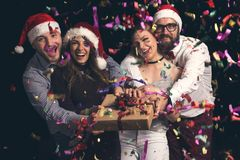 Friends and Christmas presents stock image