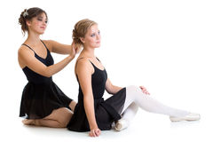 Two beautiful young dancers preparing for training together. Isolated Royalty Free Stock Photo