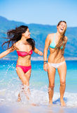 Two Beautiful Young Girls on the Beach Stock Photo