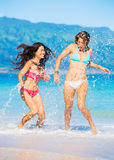 Two Beautiful Young Girls on the Beach Stock Photos