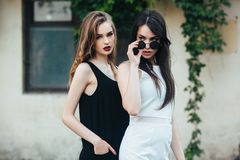 Two beautiful young girls in dresses Stock Photo