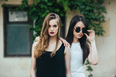 Two beautiful young girls in dresses Stock Photos