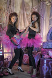 Two beautiful young girls  with electric guitar. Royalty Free Stock Photography